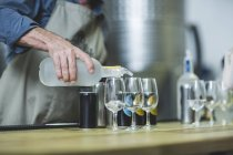 Distiller preparing spirits tasting in distillery — Stock Photo