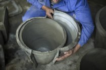 Man opening mold in industrial pot factory — Stock Photo