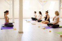 Women making exercises at prenatal yoga class — Stock Photo