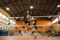 Volleyball player spiking the ball during a volleyball match — Stock Photo