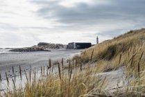 Denmark, Skagen, bunker and lighthouse at beach — Stock Photo