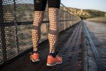 Athlete standing on a bridge — Stock Photo