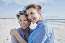 Portrait of mother and her adult daughter on the beach — Stock Photo
