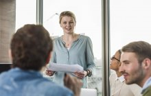 Young woman in office leading presentation — Stock Photo
