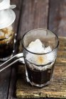 Closeup view of Vietnamese iced coffee in glasses on wood — Stock Photo