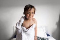 Portrait of little boy with shower towel pulling funny faces after taking a bath — Stock Photo