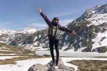 Woman standing with raised arms in mountains, Spain, Asturias, Somiedo — Stock Photo