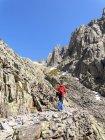 Spain, Sierra de Gredos, Rear view man hiking in mountains — Stock Photo