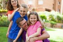 Portrait of happy caucasian family in the garden — Stock Photo