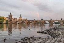 Rainbow over Charles Bridge at sunset, Prague, Czech Republic — Stock Photo