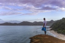 Indonesia, Sumbawa island, Young man standing on viewpoint — Stock Photo