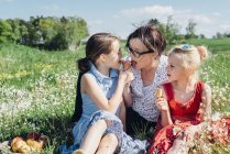 Mother and girls eating ice cream — Stock Photo