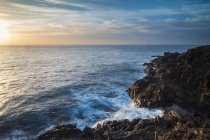 Spain, Tenerife, rocky coast at sunrise — Stock Photo