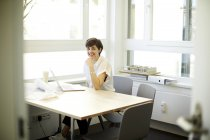 Portrait of smiling architect in her office — Stock Photo