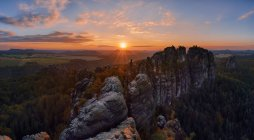Germany, Saxony, Elbe Sandstone Mountains, rocks of the Falkenstein and Schrammsteine at sunset — Stock Photo