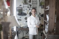 Cheerful man shopping in vintage store — Stock Photo