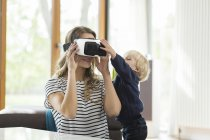 Mother with son wearing Virtual Reality Glasses — Stock Photo