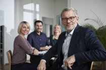 Business people having team meeting in office — Stock Photo
