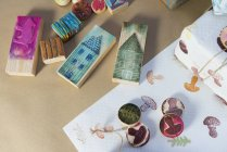 Top view of stamps and tinkering accessories lying on table — Stock Photo