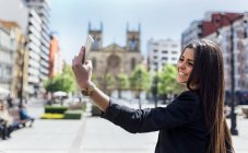 Young woman making a selfie in the city — Stock Photo
