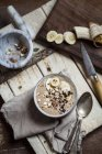 Smoothie bowl with sliced banana and roasted hazelnuts — Stock Photo