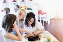 Mother and children sharing digital tablet — Stock Photo