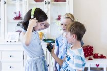 Children with cell phone and headphones — Stock Photo