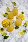 Fruit infused water with mango, lime and lemon — Stock Photo
