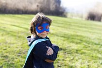 Portrait of little boy dressed up as superhero — Stock Photo