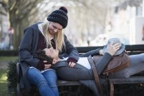 Young couple in love together on a bench — Stock Photo