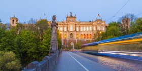 View to Maximilianeum with driving tramway on Maximilian Bridge, Munich, Germany — Stock Photo