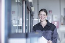 Portrait of smiling young woman in lab — Stock Photo