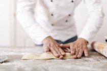 Chef shaping fresh ravioli — Stock Photo