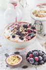 Bowl of vegan coconut yogurt with berries, puffed amaranth, pumpkin seeds and raspberry pulp — Stock Photo