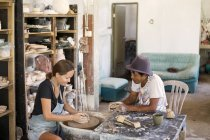 Man and woman in workshop working on pottery — Stock Photo