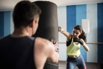 Mature woman training boxing and kickboxing in gym — Stock Photo
