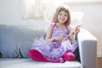 Portrait of happy little girl dressed up as fairy queen — Stock Photo