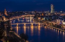 Germany, Frankfurt, Aerial cityscape and River Main at night — Stock Photo