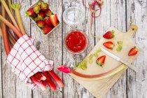 Glass of rhubarb strawberry jam — Stock Photo
