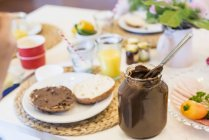 Glass with chocolate spread on table — Stock Photo