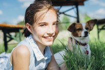 Girl with dog in meadow — Stock Photo