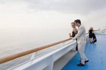 Four people with aperitive on deck of a cruise liner — Stock Photo