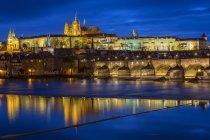 Czechia, Prague, river Vltava with Charles Bridge and Prague Castle in the evening — Stock Photo