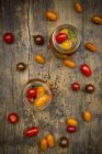 Open jars of pickled tomatoes — Stock Photo