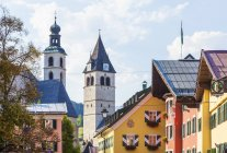 View of typical houses and churches, Kitzbuehel, Tyrol, Austria — Stock Photo