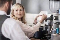 Restaurant staff at coffee bar preparing coffee — Stock Photo