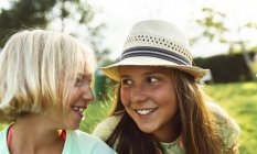 Two little girls having fun outdoors — Stock Photo
