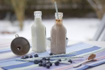 Two glass bottles of milk and cocoa — Stock Photo
