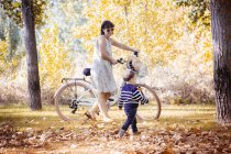 Mother with her little son in autumnal park — Stock Photo