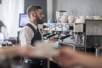 Waiter preparing coffee in modern restaurant — Stock Photo